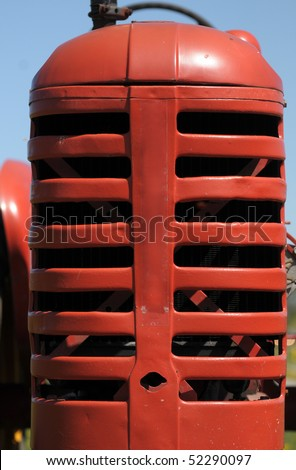Grille of an old tractor - stock photo