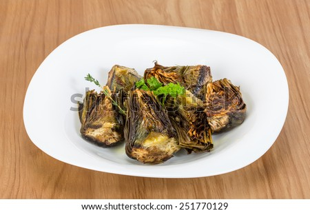 Grilled artishokes with parsley on the wood background #251770129
