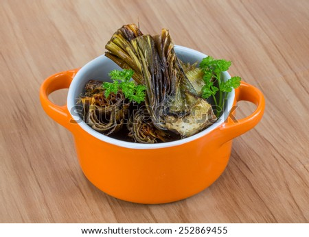 Grilled artishokes with parsley on the wood background #252869455