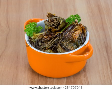 Grilled artishokes with parsley on the wood background #254707045