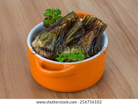 Grilled artishokes with parsley on the wood background #256756102