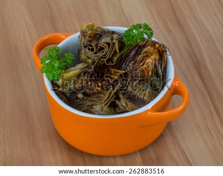 Grilled artishokes with parsley on the wood background #262883516