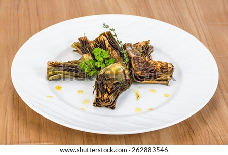 Grilled artishokes with parsley on the wood background #262883546