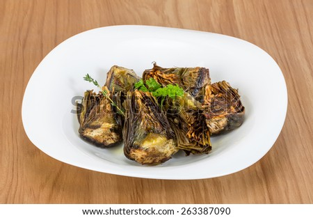 Grilled artishokes with parsley on the wood background #263387090