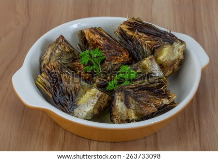 Grilled artishokes with parsley on the wood background #263733098