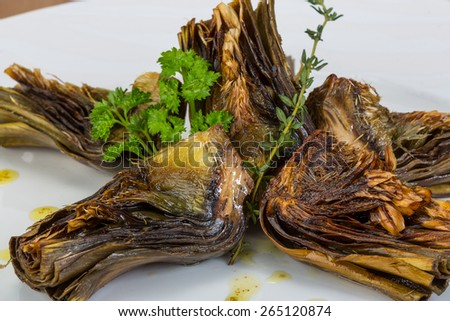 Grilled artishokes with parsley on the wood background #265120874
