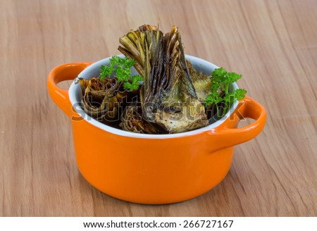 Grilled artishokes with parsley on the wood background #266727167