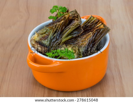 Grilled artishokes with parsley on the wood background #278615048