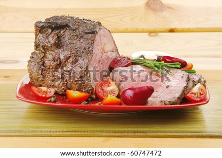 grilled barbecue on red dish with vegetables