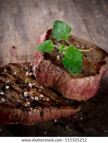 Grilled bbq steaks with fresh herb