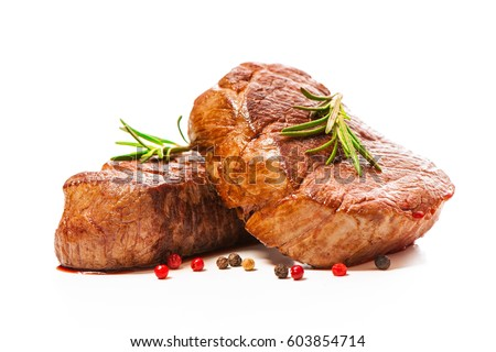 Grilled beef fillet steaks with herbs and spices isolated on white background #603854714