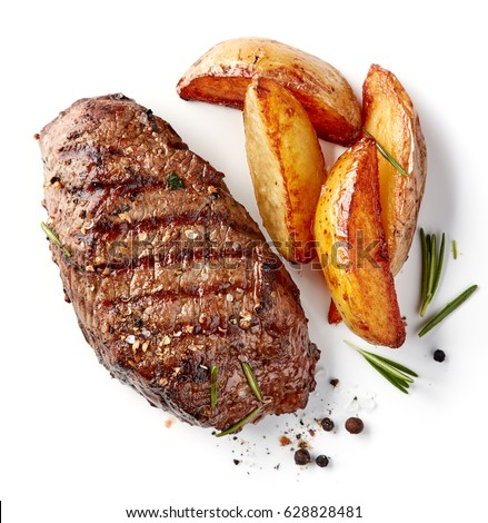 grilled beef steak and potatoes isolated on white background, top view