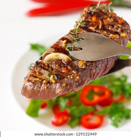 Grilled beef steak and vegetable salad for dinner.