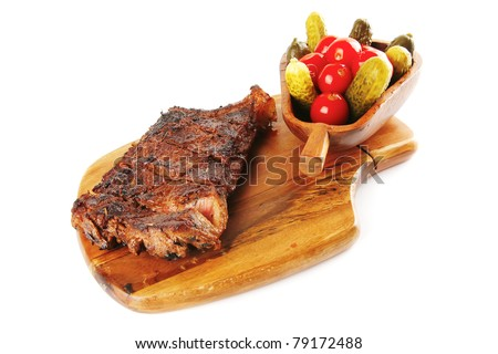 grilled beef steak and vegetables on wooden plate