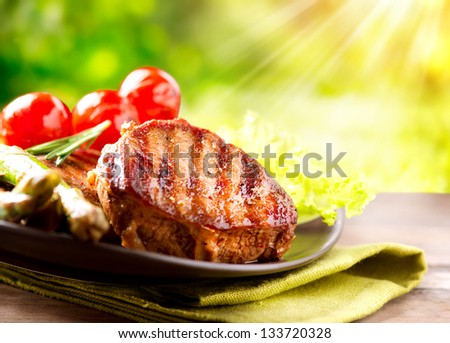 Grilled Beef Steak BBQ. Barbecue Meat Steak outdoor with Vegetables