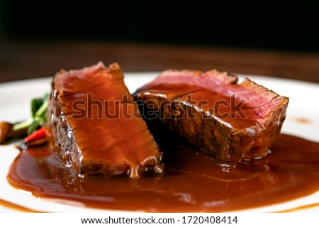 Grilled beef Steak filet Mignon medium rare pour demi-glace sauce Сток-фото ©