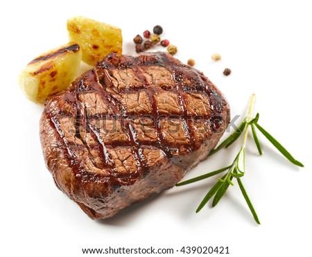 grilled beef steak with spices isolated on white background