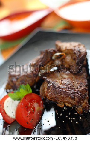 Grilled beef with tomatoes and mozzarella .Serving grilled poultry meat served on white ceramic plate