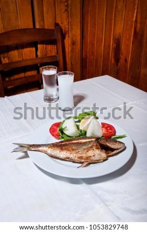 Grilled bluefish and turkish raki in Turkish tavern Stok fotoğraf ©