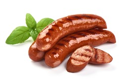 Grilled bratwurst Pork Sausages with basil leaves, close-up, isolated on white background.