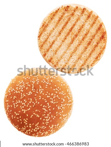 Grilled burger bun isolated on white background. Close up.
