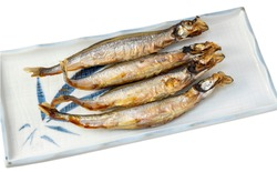 Grilled Capelin with eggs on square plate