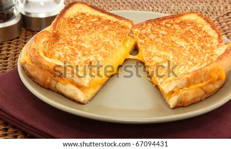 Grilled Cheese Sandwich Served On A Plate