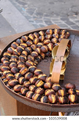 Grilled chestnuts for sale in a market stall