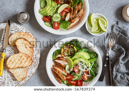 Grilled chicken and fresh vegetable salad. Healthy diet food concept. On a light background, top view
