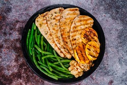Grilled chicken breast and green beans . Selective focus.Grilled chicken fillet with green beans.