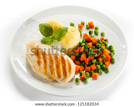 Grilled chicken breast, boiled potatoes and vegetable salad