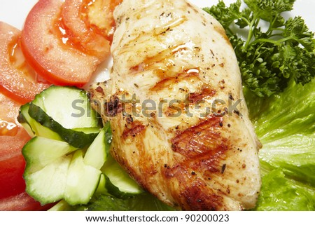 Grilled chicken breast served with lettuce and tomato