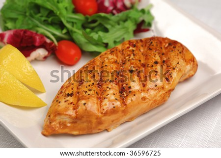 Grilled chicken breast with fresh salad