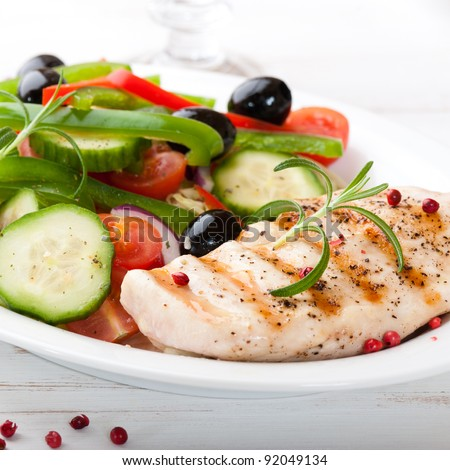 Shutterstock Grilled chicken breast with fresh vegetables
