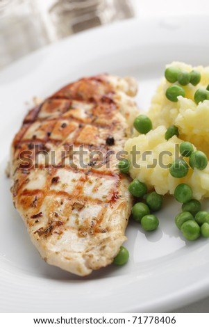 Grilled chicken breast with mashed potato and green pea