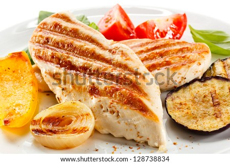 Grilled chicken breasts and vegetables