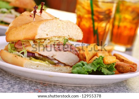 Grilled chicken cordon bleu with ham sandwich at an outdoor cafe