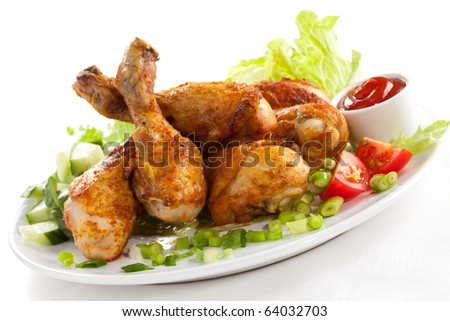 Grilled chicken drumstick and vegetables