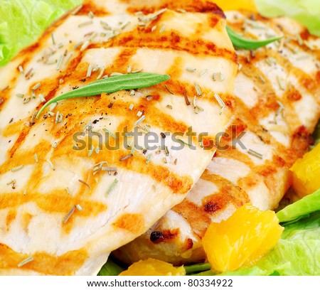 Grilled chicken fillet with rosemary and orange, tasty meal, healthy eating concept