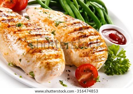 Grilled chicken fillets and vegetables  #316474853