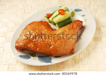 Grilled chicken leg on plate