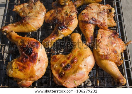 Grilled chicken legs are cooked in the restaurant