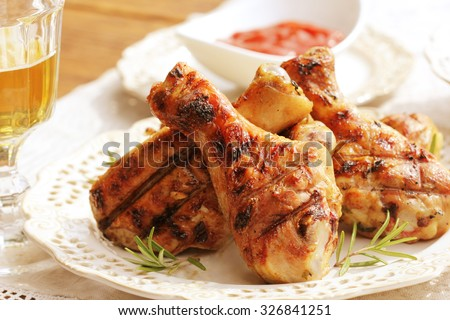 Grilled chicken legs with rosemary #326841251