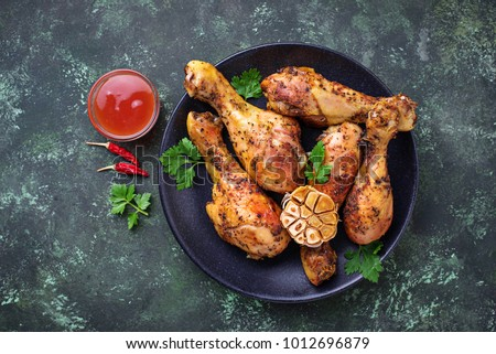 Grilled chicken legs with spices and garlic. Top view