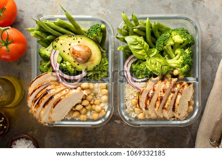 Grilled chicken meal prep containers with cooked rice and vegetables