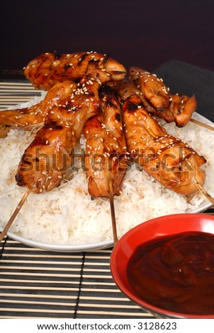 Grilled chicken satay with rice and a honey BBQ dipping sauce