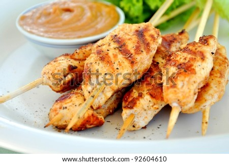 Grilled chicken skewers with peanut butter sauce - stock photo