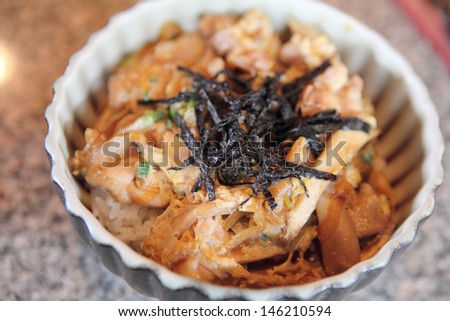 Grilled Chicken teriyaki rice on wood background