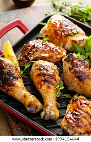 Grilled chicken thighs and drumsticks with sweet honey glaze Stok fotoğraf ©