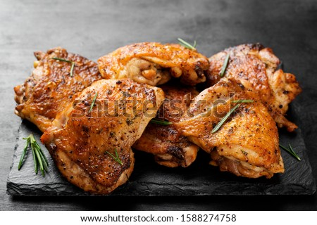 Grilled chicken thighs with spices and lemon.  ストックフォト ©